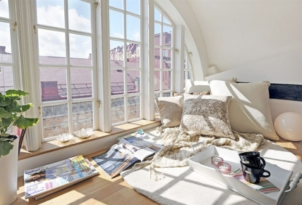 A sunny reading loft in a Swedish apartment.